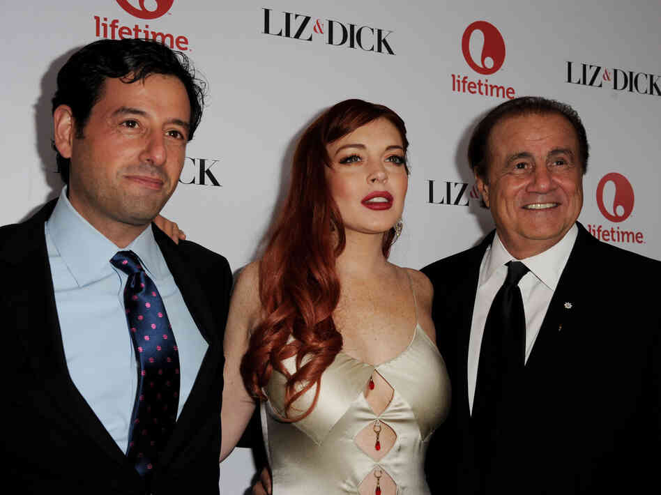 Producer Larry Thompson (right) took out incarceration insurance on Lindsay Lohan for her role in Lifetime's Liz and Dick.