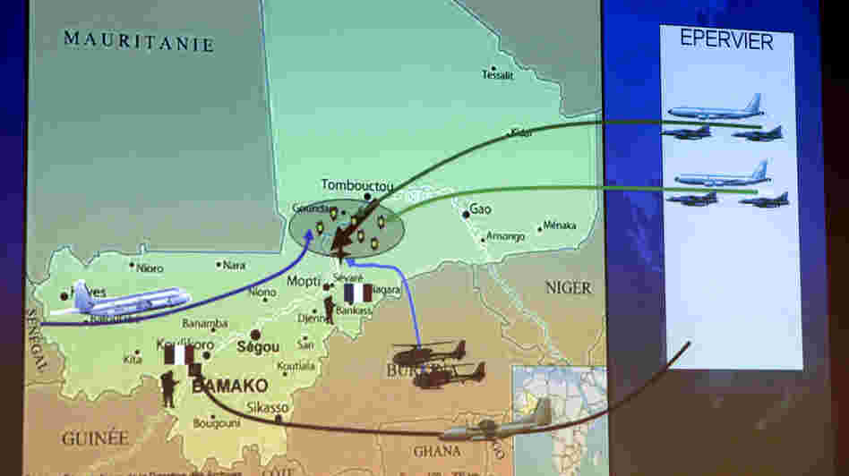 A map shown Sunday during a news conference held by French Defense Minister Jean-Yves Le Drian in Paris shows the movement of French troops and aircraft n Mali.