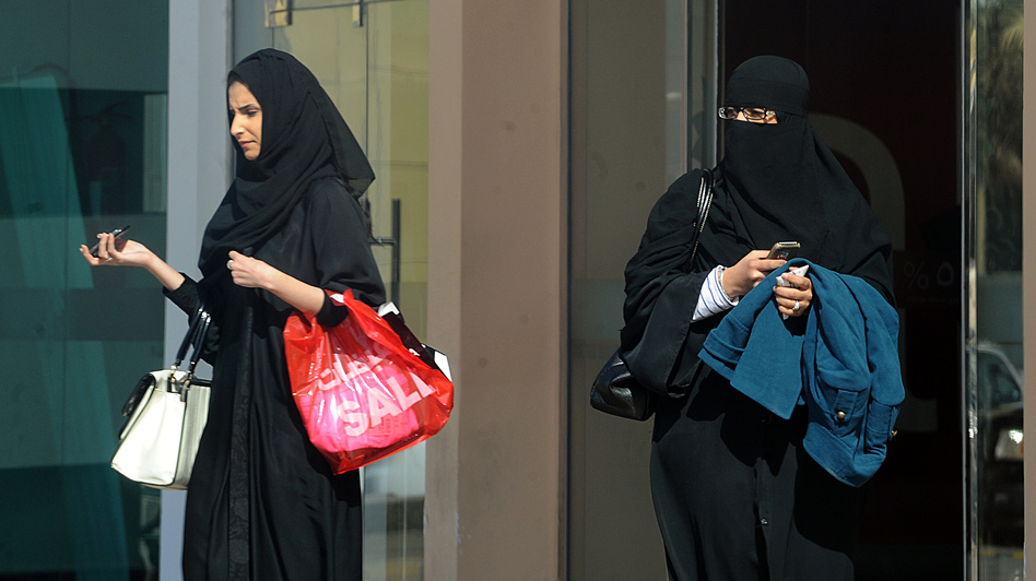 Saudi women leave a shopping mall in the capital, Riyadh, on Saturday. King Abdullah has introduced a number of reforms for women during his rule, but they still face many restrictions. (AFP/Getty Images)