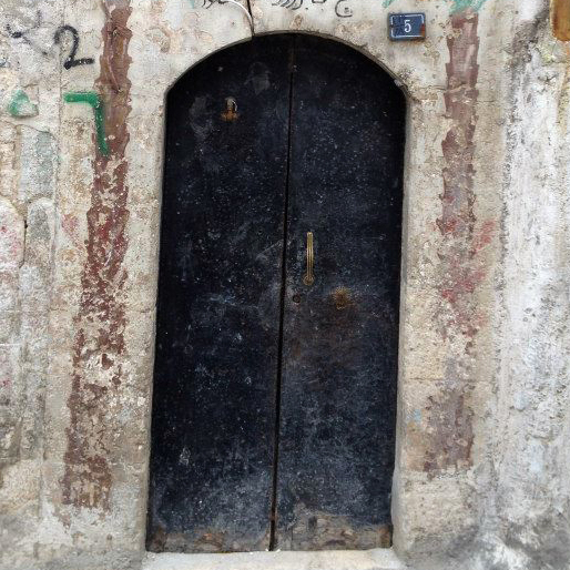 The ancient city of Aleppo in northern Syria has been the scene of heavy fighting. Many homes that have survived have inscriptions above the doorways that note the owner has made the pilgrimage of Islam's holiest site, Mecca.