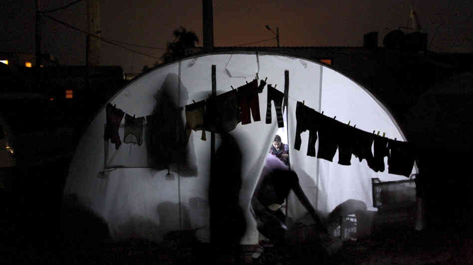 Clothes are hung to dry outside a tent housing Syrian refugees in Bab al-Salam refugee camp in A