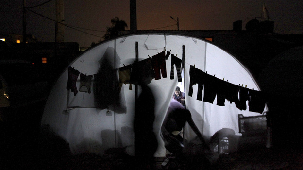 Clothes are hung to dry outside a tent housing Syrian refugees in Bab al-Salam refugee camp in Azaz, near the Syrian-Turkish border, on Sunday. (Reuters/Landov)