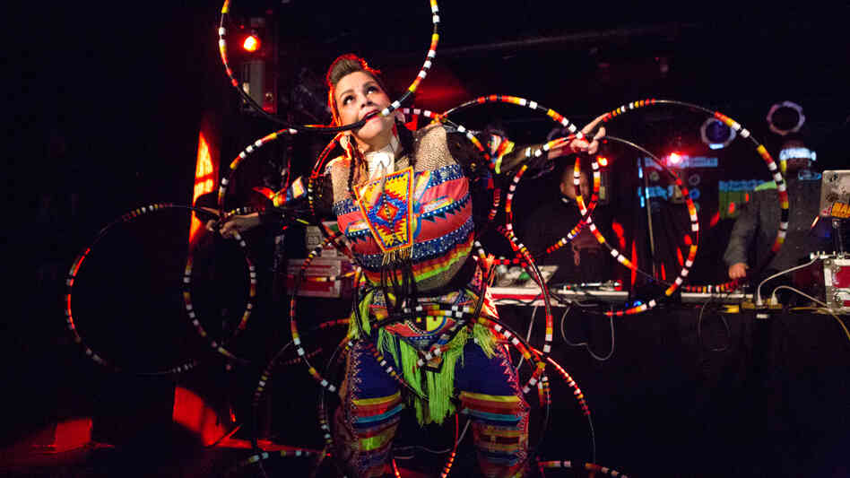 A hooper dances to Canadian electronic group A Tribe Called Red at globalFEST 2013.