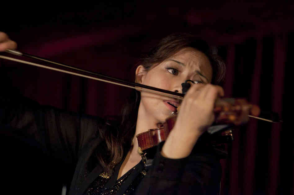 Violinist Meg Okura led what she called a Pan Asian Chamber Jazz Ensemble in a program of compositions by Ryuichi Sakamoto.
