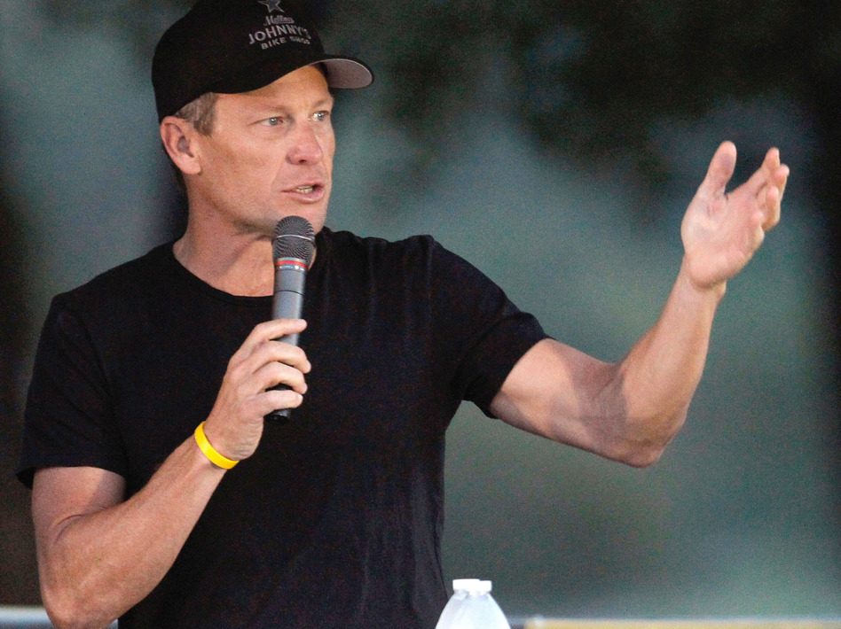 Cyclist Lance Armstrong addresses participants at a Livestrong event in October.