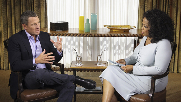 Lance Armstrong speaks with Oprah Winfrey during taping for the show Oprah and Lance Armstrong: The Worldwide Exclusive in Austin, Texas, on Monday. The interview airs Thursday and Friday on the Oprah Winfrey Network. (AP)