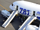 An All Nippon Airways flight sits at Takamatsu airport in Takamatsu, Japan, after it made an emergency landing Wednesday.
