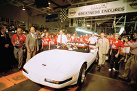 Assembly line workers follow the one-millionth Corvette as the car is pulled off the end of the assembly line in Bowling Green, Ky., on July 2, 1992. The white car with red seats duplicated the colors of the first Corvette, built in 1953.