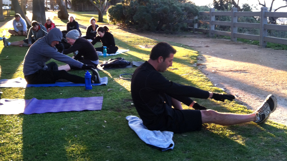 Boot camp participants at an early morning class in Palisades Park in Santa Monica, Calif. (NPR)