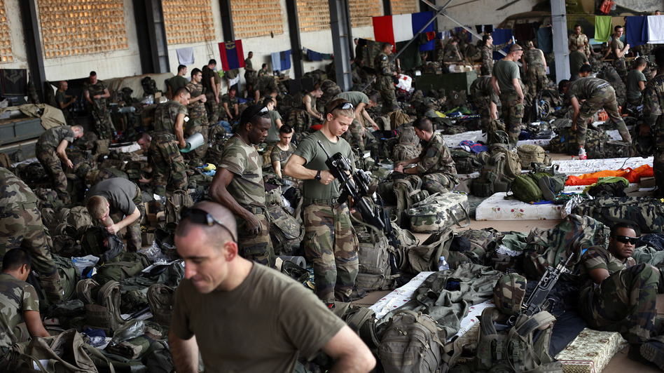 French troops gather in a hangar at Mali's Bamako airport. French forces led an all-night aerial bombing campaign against armed Islamist extremists Tuesday. (AP)