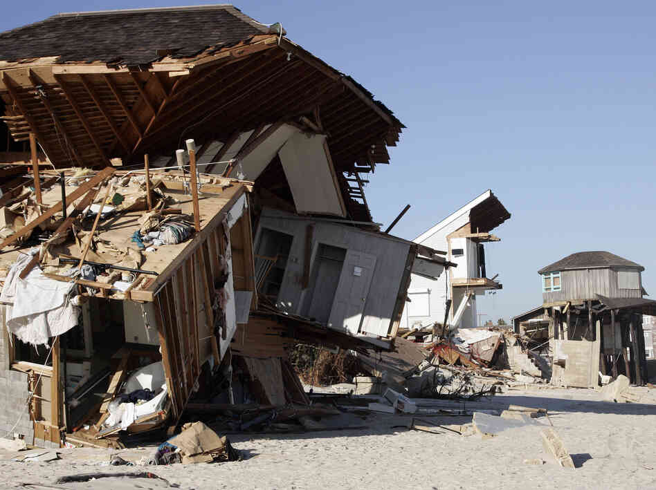 Shattered homes lined the beach front in Mantoloking, N.J., after Sandy tore through. The superstorm caused billions of dollars in damage to New Jersey, New York and surrounding states.