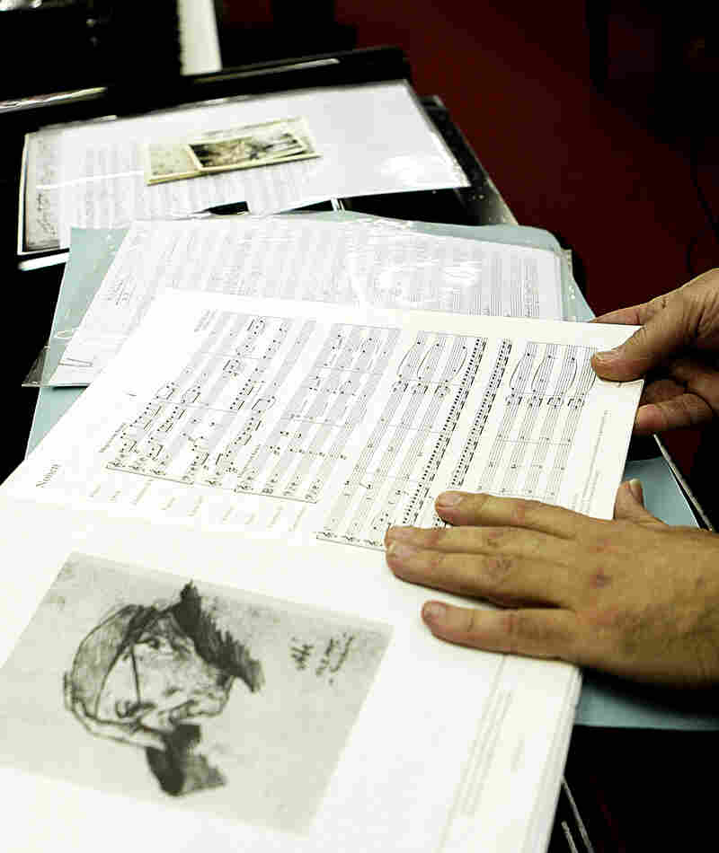 Lotoro displays a copy of music by Rudolf Karel, a Czech composer (in 1945 sketch at left) imprisoned by Nazis for helping the resistance in Prague, in a music shop in Rome, Feb. 22, 2007. Denied access to regular paper, Karel wrote his compositions down on toilet paper. He died of dysentery at the Terezin camp.