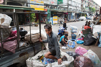 The Klong Toei slum in Bangkok is 5 miles away from a glamorous shopping center that caters to an emerging middle class.