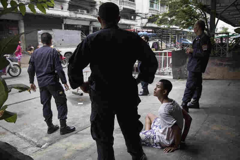 Anti-terrorism police arrest a drug addict as part of rehabilitation program in Klong Toei.