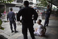 Anti-terrorism police arrest a drug addict as part of rehabilitation program in Klong Toei.