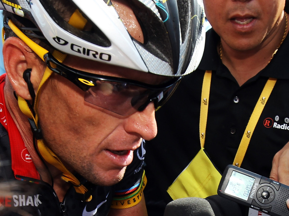 Armstrong talks to the press at the finish line of stage eight of the 2010 Tour de France. (Getty Images)