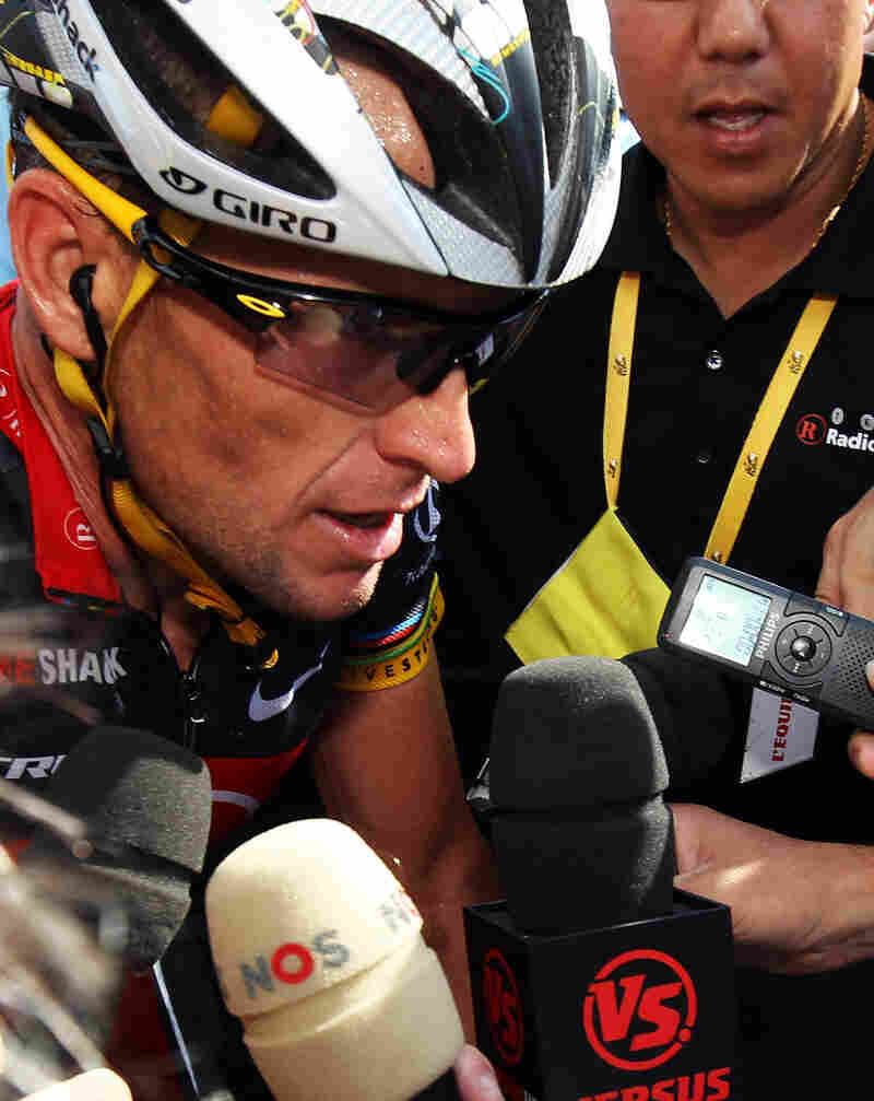 Armstrong talks to the press at the finish line of stage eight of the 2010 Tour de France.