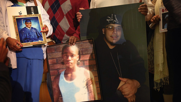 Community leaders and family members of murder victims attend a press conference Jan. 3 at St. Sabina Church in Chicago to make a plea for stronger gun regulations. (Getty Images)