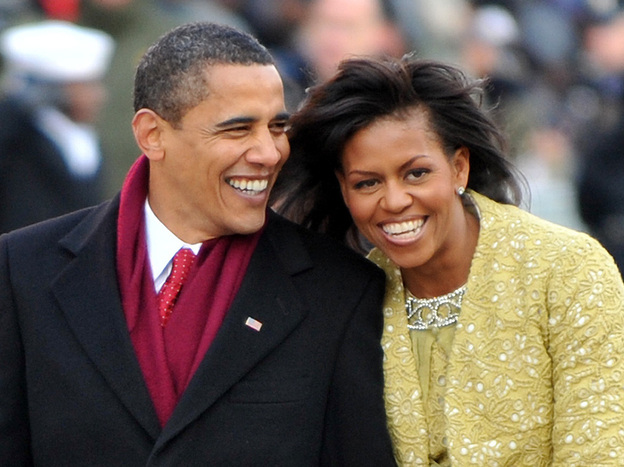 President Barack Obama and first lady Michelle Obama walk in the Inaugural Parade on Jan. 20, 2009 in Washington, D.C.