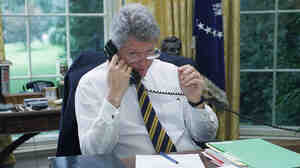 President Clinton speaks to a member of the House on Aug. 11, 1994, lobbying for votes for the crime bill.