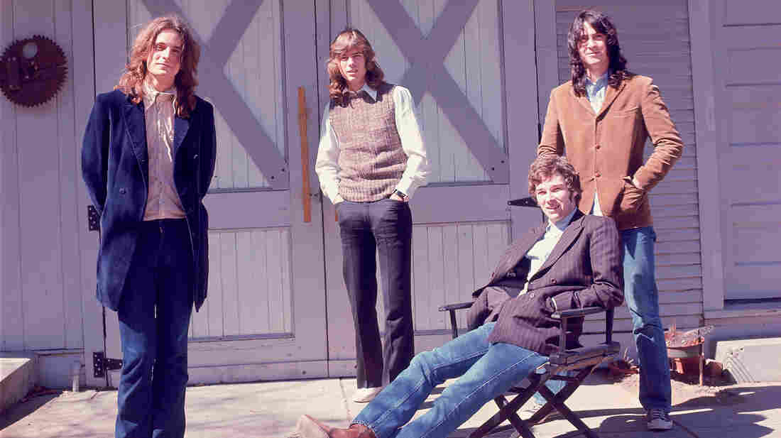 Big Star's members pose in front of their barn.