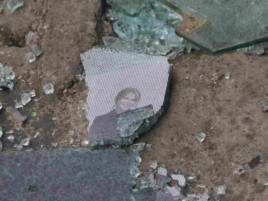 Glass, and remnants of a picture, on the street at the scene of the bombing in Kabul.
