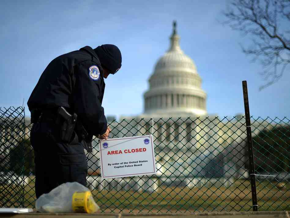 A U.S. Capitol Police officer secures the area surrounding the west front of the Capitol in Washington, D.C., on Jan. 5 as preparations are under way for President Obama's second inauguration.