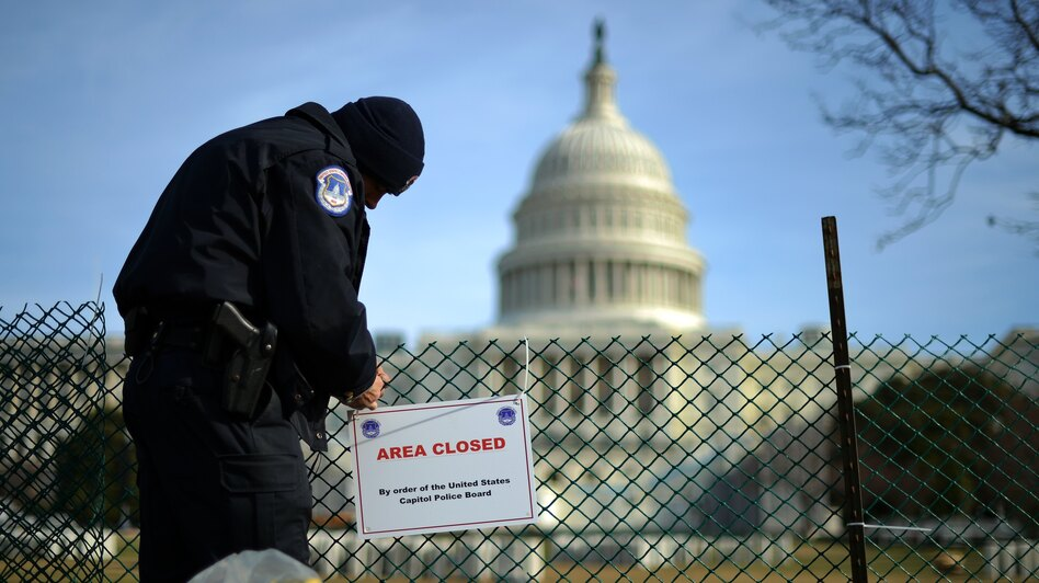 A U.S. Capitol Police officer secures the area surrounding the west front of the Capitol in Washington, D.C., on Jan. 5 as preparations are under way for President Obama's second inauguration. (AFP/Getty Images)