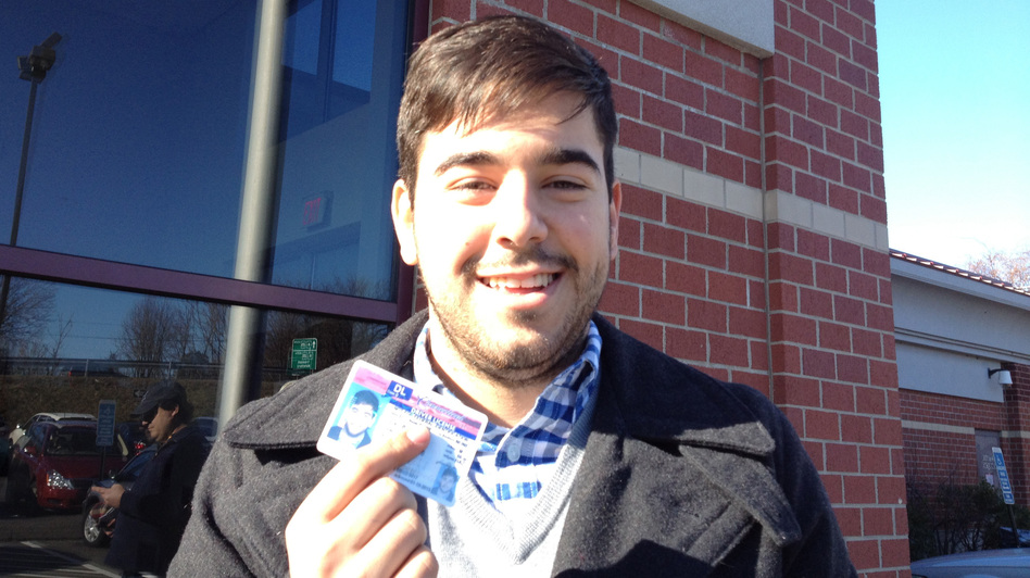 Lucas Codognolla, 22, receives his license after qualifying for it under President Obama's federal immigration policy, which allows some young immigrants who are in the country illegally to stay in the U.S. for at least two years. (Craig LeMoult for NPR )