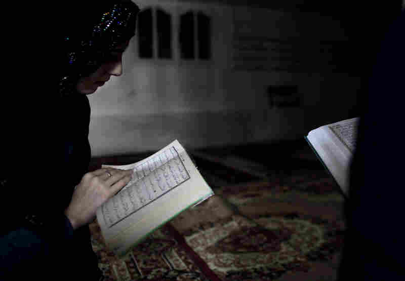 Chechen girls study the Quran at an underground madrassa in the Chechen village of Serzhen-Yurt. The new generation of youth are embracing Islam after decades of religious repression by secular Communist authorities in the Soviet Union.