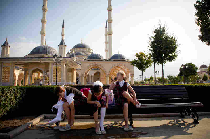 Chechen girls after school in front of the Heart of Chechnya mosque, the largest in Europe. All Chechen girls, despite their religion, must wear a head covering in public schools and government buildings.