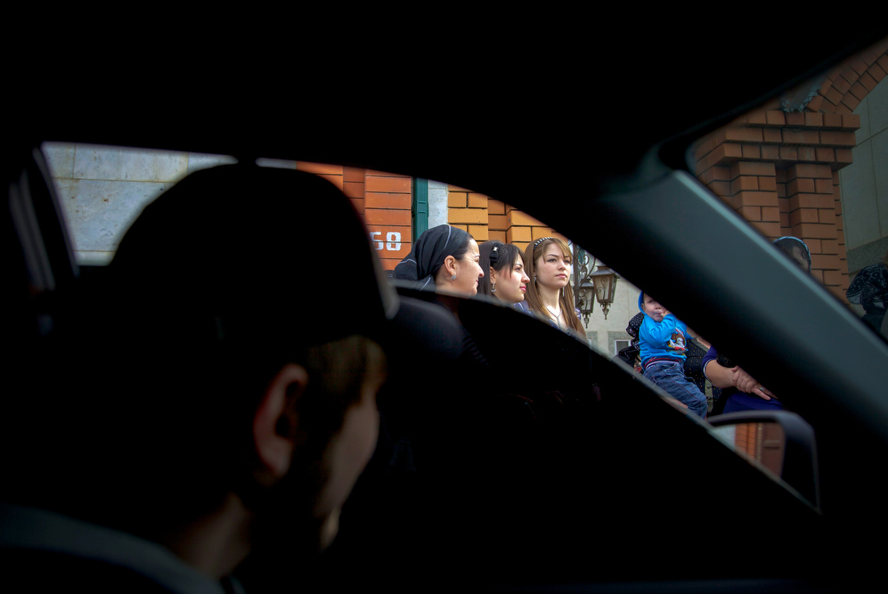 A Chechen boy checks out a girl from his black tinted window. Despite official measures, bride kidnapping continues to be an endemic problem: Young women in Chechnya are kidnapped off the street and married to men they may never have met.