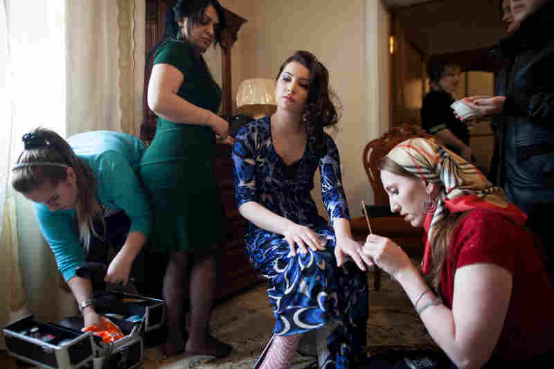 Layusa Ibragimova, 15, has her hair and nails done before her wedding. Her marriage to 19-year-old Ibragim Isaev was finalized by her father just weeks before.