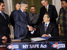 State Senator Jeff Klein (L-R), Assembly Speaker Sheldon Silver, Lieutenant Governor Robert Duffy and Senator Andrea Stewart-Cousins congratulate New York Governor Andrew Cuomo after he signed the New York Secure Ammunition and Firearms Enforcement Act on Tuesday.