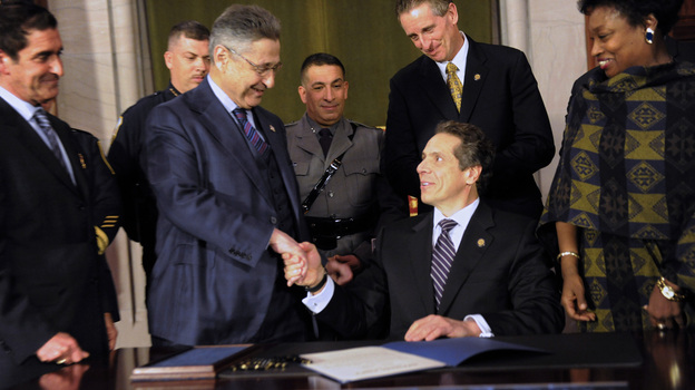 State Senator Jeff Klein (L-R), Assembly Speaker Sheldon Silver, Lieutenant Governor Robert Duffy and Senator Andrea Stewart-Cousins congratulate New York Governor Andrew Cuomo after he signed the New York Secure Ammunition and Firearms Enforcement Act on Tuesday. (Reuters/Landov)