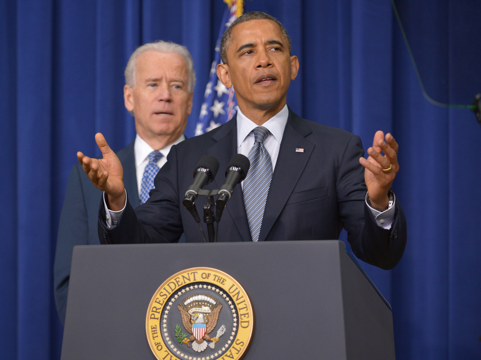 President Obama at the White House today, with Vice President Biden in the background. (Mandel Ngan/AFP/Getty Images)