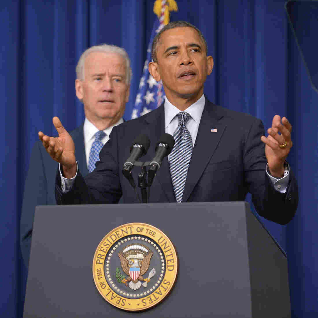 President Obama at the White House today, with Vice President Biden in the background.