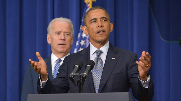 President Obama at the White House today, with Vice President Biden in the background. (AFP/Getty Images)
