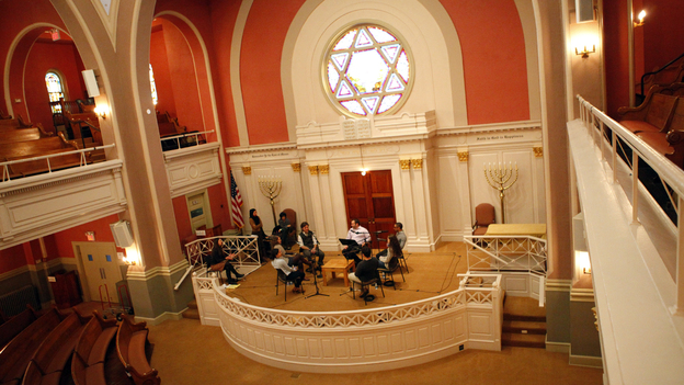 NPR's David Greene leads a discussion about religion with a group of young adults at the Sixth & I Historic Synagogue in Washington, D.C. (NPR)