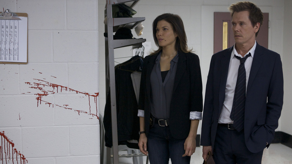 Jeannane Goossen and Kevin Bacon star as FBI special agents tracing a network of serial killers in Fox's new crime drama <em>The Following.</em>
