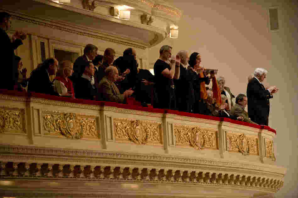 In the balcony at Carnegie Hall, audience members give violinist Leonidas Kavakos and the Philadelphia Orchestra a standing ovation for their performance of the Violin Concerto No. 2 by Karol Szymanowski.