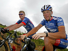 Lance Armstrong, right, faces several court cases tied to evidence that he cheated. One of the suits was filed by his former U.S. Postal Service teammate Floyd Landis. Here, the pair ride during the 2003 Tour de France.