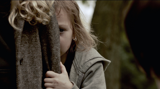 Victoria (Megan Charpentier) and her sister, Lilly (Isabelle Nelisse), are near-feral orphans in the horror thriller Mama. (Universal Pictures)