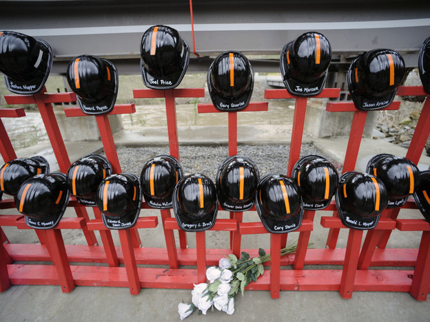 Mine helmets and painted crosses were placed at the entrance to Massey Energy's Upper Big Branch coal mine as a memorial to the 29 miners killed there.