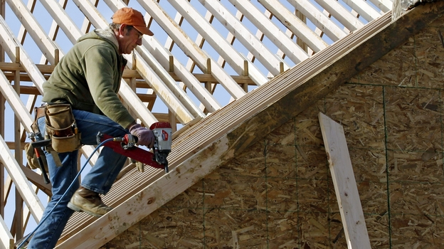 New homebuilding reached a 4 1/2 year high in December, welcome news for an industry that lost 2 million jobs during the downturn. Despite those job losses, the sector is experiencing a labor shortage in some parts of the U.S. (AP)
