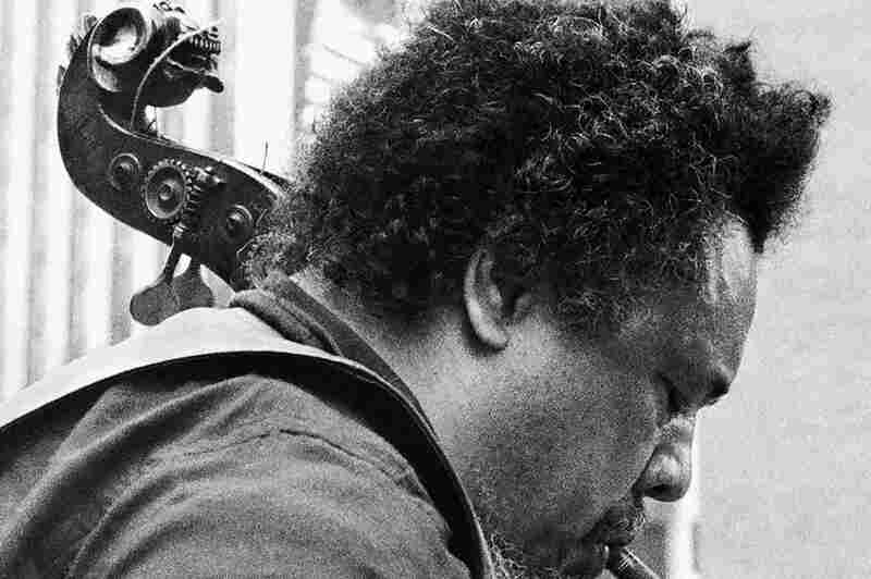 Charles Mingus in 1976, pictured with his lion's head bass, which is now played by the Mingus Orchestra's Boris Kozlov.