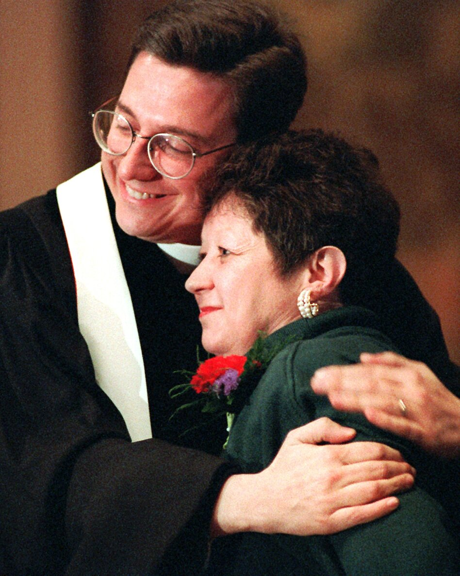 "Norma McCorvey, the ""Jane Roe"" of the 1973 decision, embraces the Rev. Robert L. Schenck of the National Clergy Council before she addresses a memorial service at Georgetown University in Washington, D.C., on Jan. 21, 1996. A year earlier McCorvey shocked abortion-rights advocates by becoming a spokeswoman for the other side of the debate, stating she no longer supported abortion rights. (AP)"