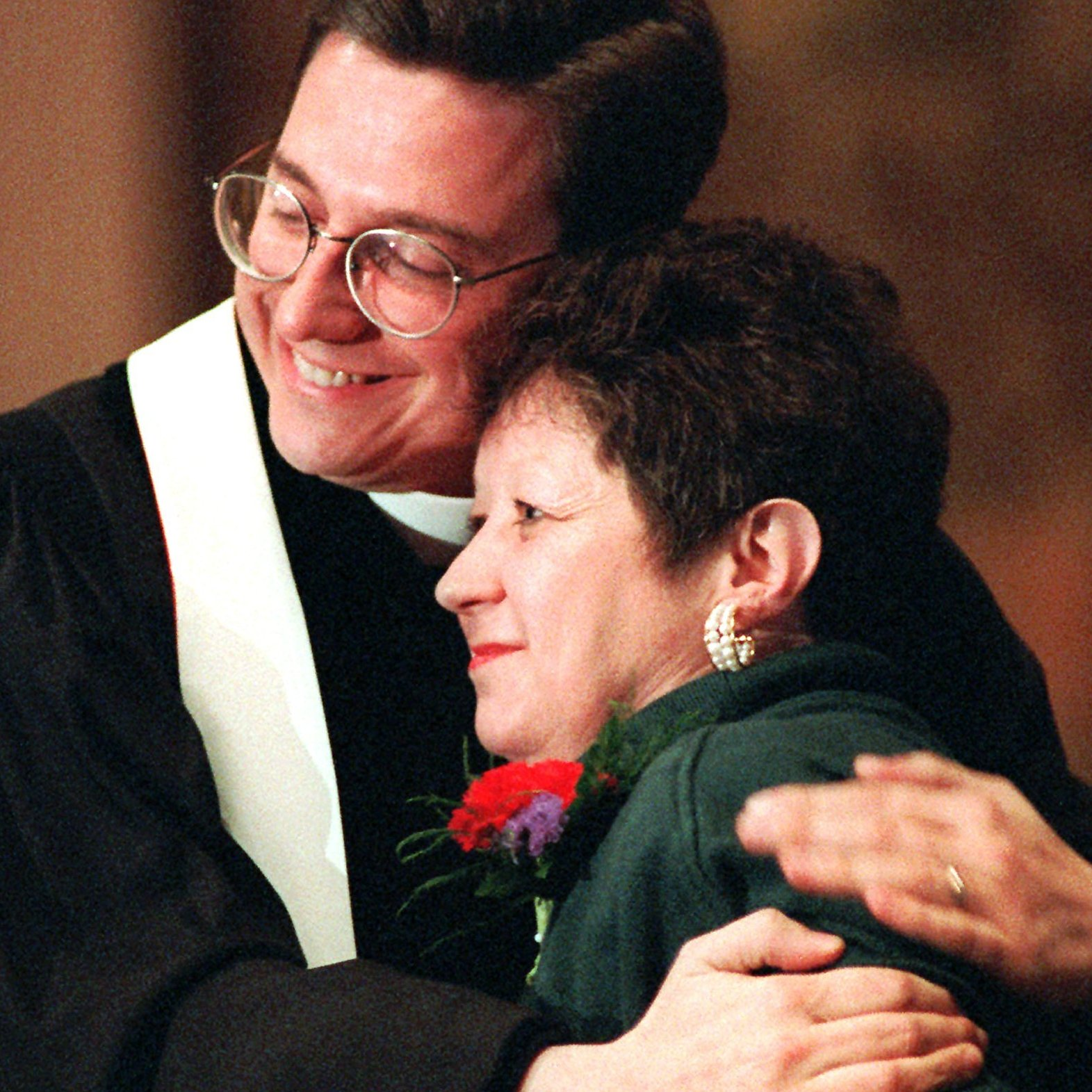"Norma McCorvey, the ""Jane Roe"" of the 1973 decision, embraces the Rev. Robert L. Schenck of the National Clergy Council before she addresses a memorial service at Georgetown University in Washington, D.C., on Jan. 21, 1996. A year earlier McCorvey shocked abortion-rights advocates by becoming a spokeswoman for the other side of the debate, stating she no longer supported abortion rights."