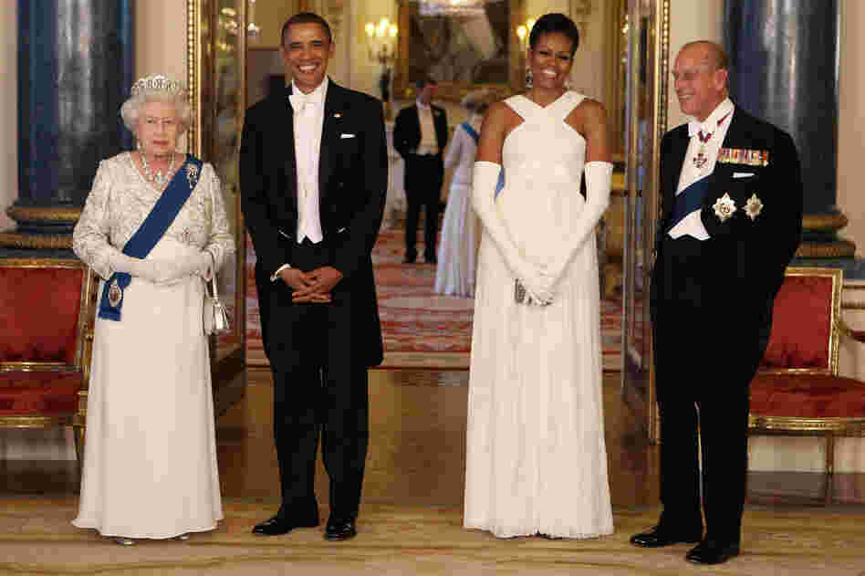 Diplomacy with style: The Obamas pose with Queen Elizabeth II and Prince Philip at Buckingham Palace ahead of a state banquet on May 24, 2011. Michelle's gown was designed by American fashion designer Tom Ford.