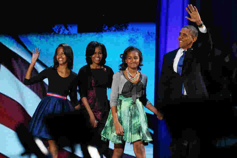 First family: Obama walks on stage with his family to deliver his victory speech on election night on Nov. 6, 2012, in Chicago.